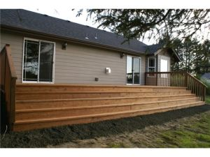 Canal side of home features a 10x32' deck with sliding doors fro